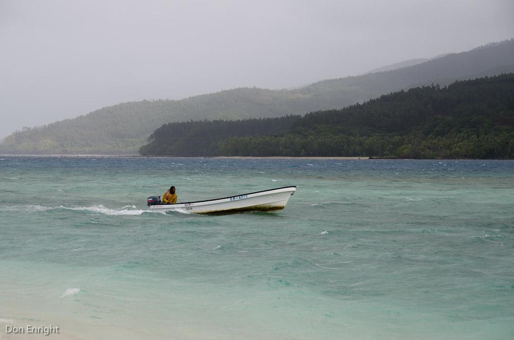 boat approaching Mystery Island