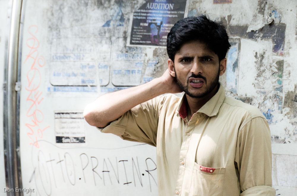 man looking at camera, mumbai