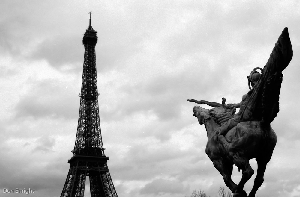 statue and eiffel tower