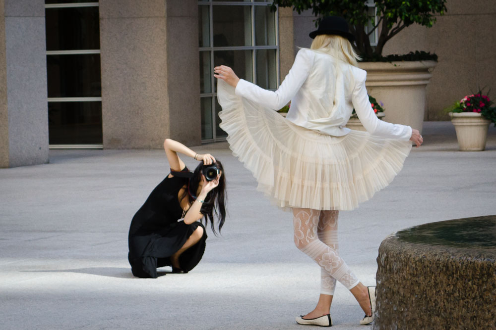 Woman curtseying in street